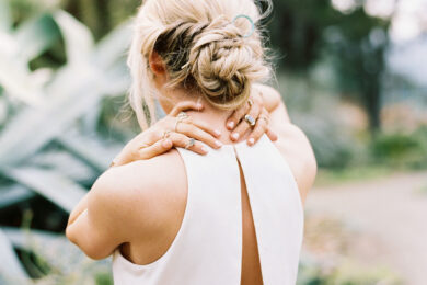 Women with her back to the camera massaging her neck from burnout